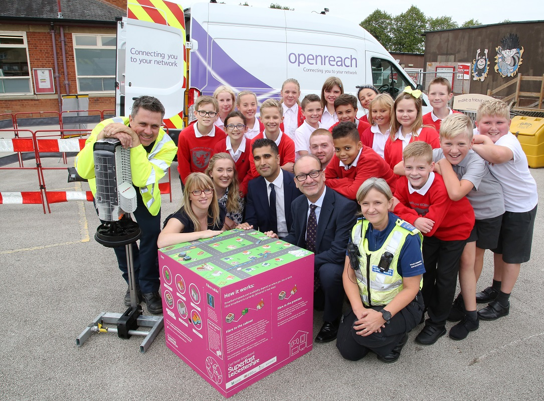 Brownlow Primary School children with Openreach, Tom Purnell (Assistant Chief Executive at Leicestershire County Council) and Superfast Leicestershire project team members.